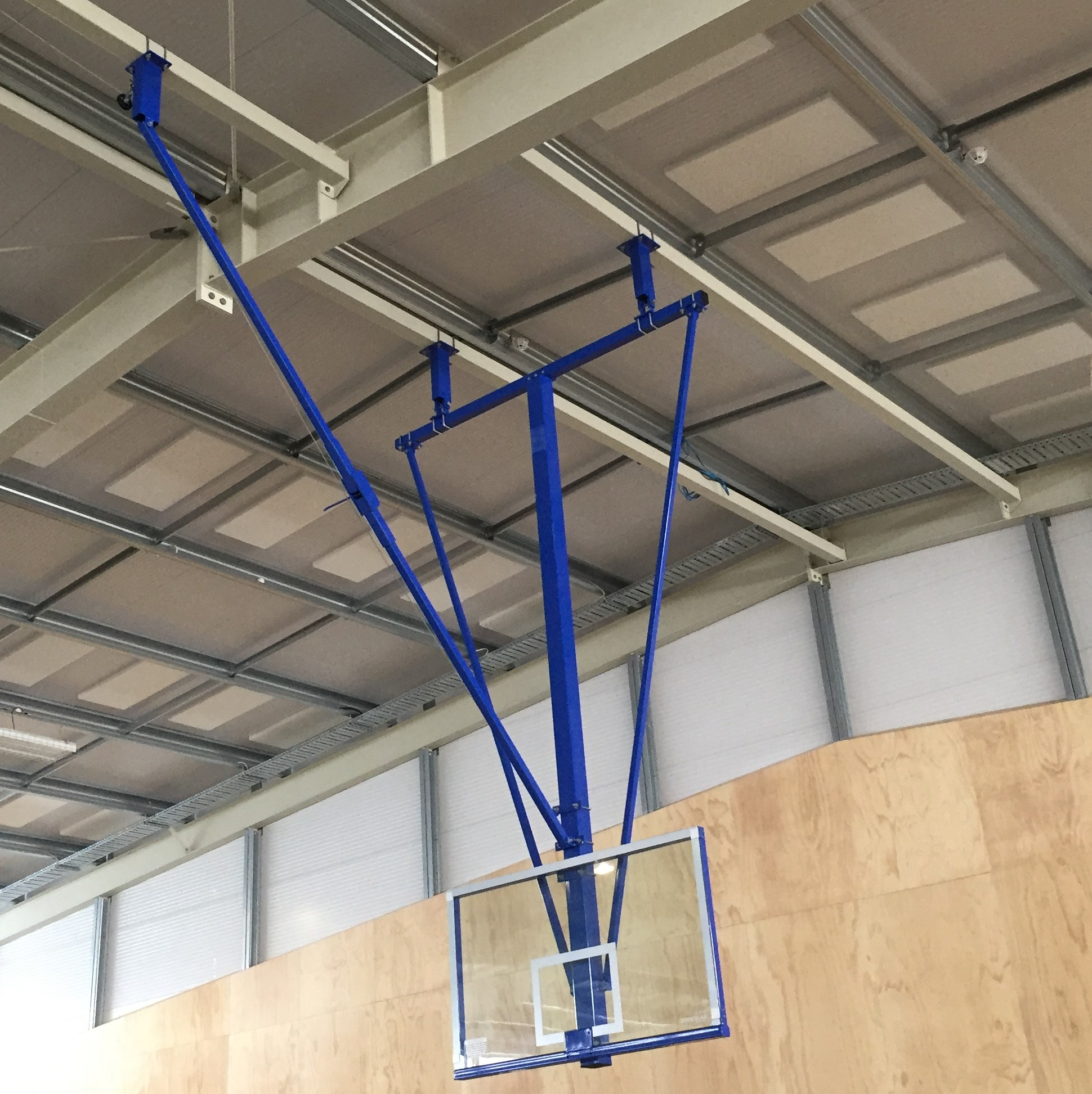 Ceiling mounted universal fold basketball system grand Indoor basketball court ceiling height